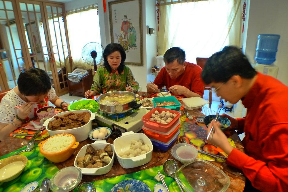 Everyone eating merrily. By Edmund Yeo [CC BY-NC-SA-2.0], via Flickr