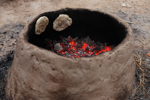 What a tannur looked like! You can see how they slapped the bread to the sides of the cylinder to oven bake.