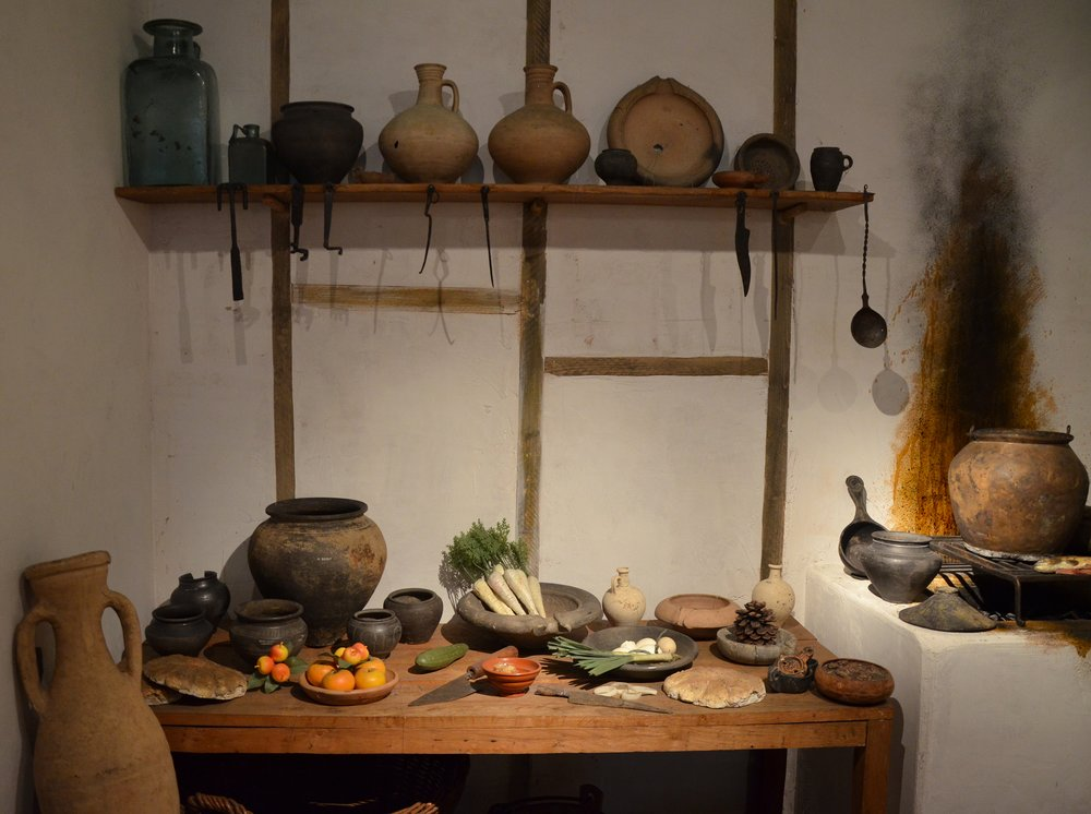 Food of Ancient Roman cuisine   Reconstructed Roman kitchen (culina), Museum of London. By Carole Raddato (Own work), [ CC BY-SA 2.0 ],  flickr .