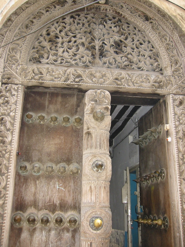 Carved door in Stone Town - the historic part of Zanzibar City. By Eirik Newth 2004, via Wikimedia Commons. CC-BY-2.0.