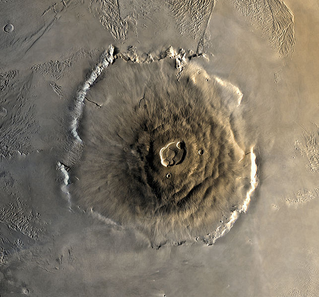 A composite Viking orbiter image of Olympus Mons on Mars, the tallest known volcano and mountain in the Solar System. By Image by NASA, modifications by Seddon [Public domain], via    Wikimedia Commons   .