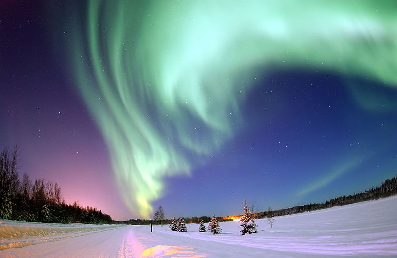 The Aurora Borealis, or Northern Lights, shines above Bear Lake .By United States Air Force photo by Senior Airman Joshua Strang [Public domain], via    Wikimedia Commons   .