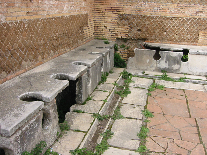 Ancient Roman latrines/latrinae, Ostia Antica . Image retrieved from  Wikimedia Commons  on 14 October 2016.