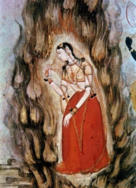 Sita passing through the fire to prove her innocence. By Unknown via Wikimedia Commons.