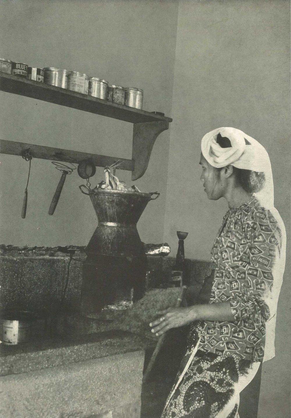 Woman cooking ketupat. By  Ch Sj Dt Tumenggung. [Public Domain]. Via Wikimedia commons.