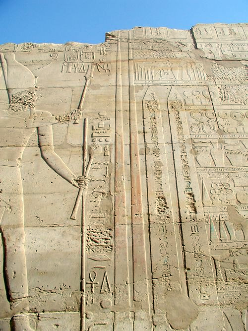 Figure of Tuthmoses III at Karnak holding a Hedj Club and a Sekhem Scepter standing before two obelisks he had erected there , 30 December 2006,  Copyrighted free use