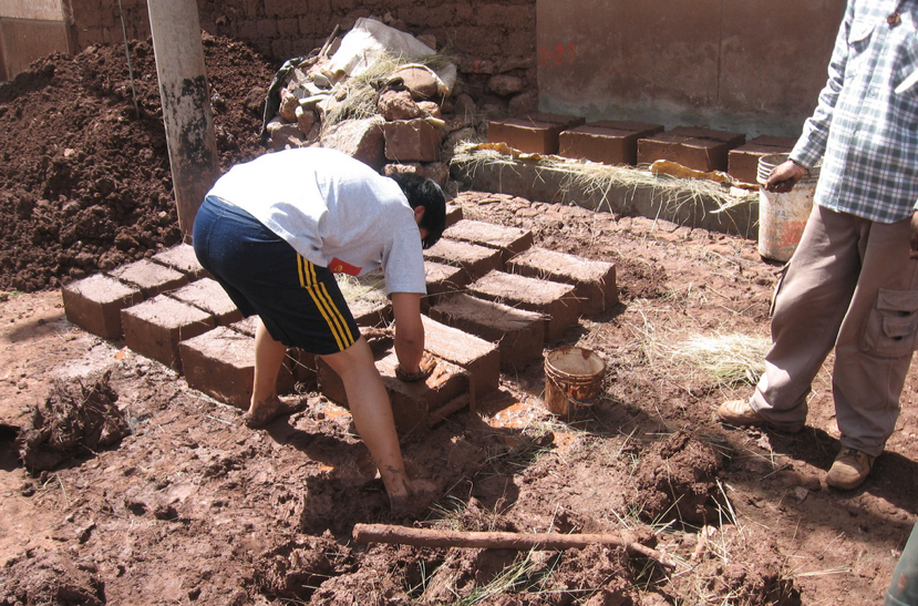 The making of sun dried clay bricks, Peru, April 16, 2009. Public Domain.