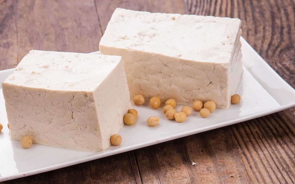 Phonet,  Tofu  4, (7 January 2018), Creative Commons. Alt Text: Photo of a plate with two pieces of soybean curd, or tofu.