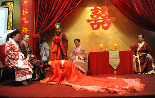 Beijing Time,  A Han style wedding where the bride bows to her parents for well wishes.