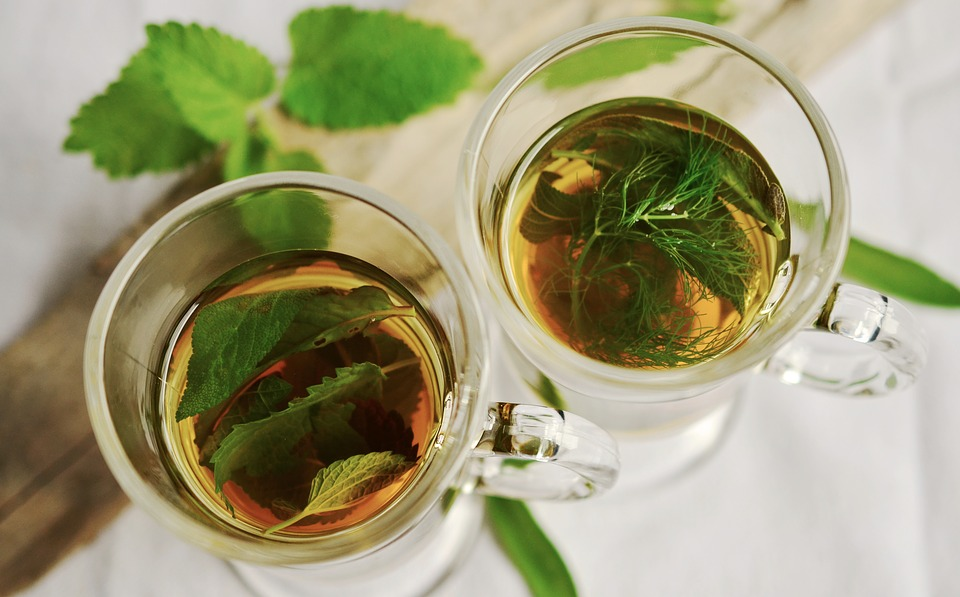 Congerdesign,  H  erbal Tea  (23 May 2016). CC BY 1.0  Alt text: Photo of two transparent glasses with medicinal tea leaves infused in water