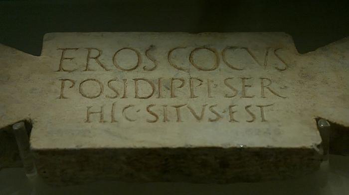 "Jastrow - Corpus Inscriptionum Latinarum. ""Here lies Eros, Posidippus' chef, a slave"":  Epitaph on a Stele , (2006)."