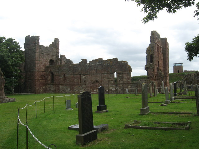 James Denham.  The Ruins of Lindisfarne Priory.  2013. Graveyard alongside red brick ruins of a Christian monastery that was raided and destroyed by Vikings in Northumberland, Great Britain, during the battle of Lindisfarne in 793 CE. The battle of Lindisfarne is considered by most historians to be the beginning of the Viking Age.