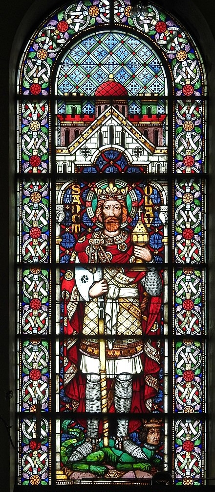 Holger Uwe Schmitt.  The Alesund Church was completed in 1909.  2016. A portrait of King Olav II Haraldsson on a stained glass window at Alesund Church located in Norway.