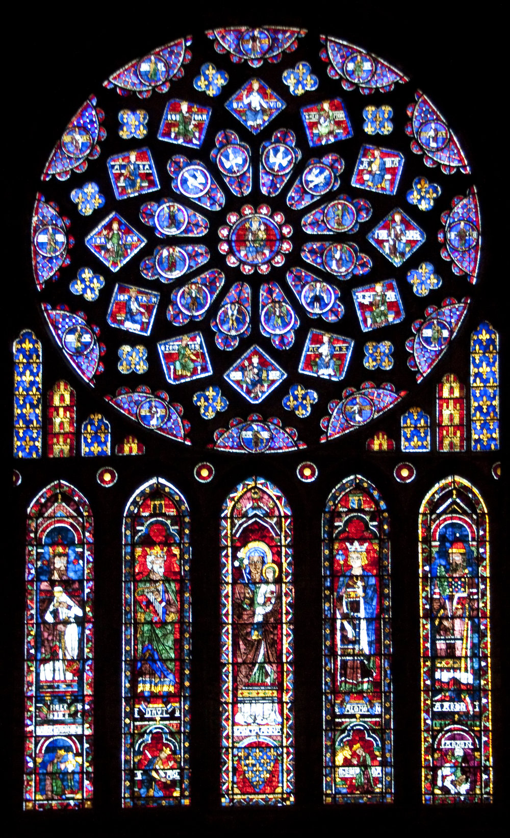 Tony Hisgett,  Stained glass rose window Chartres Cathedral , July 30, 2009. Vivid coloured stained glass in church.