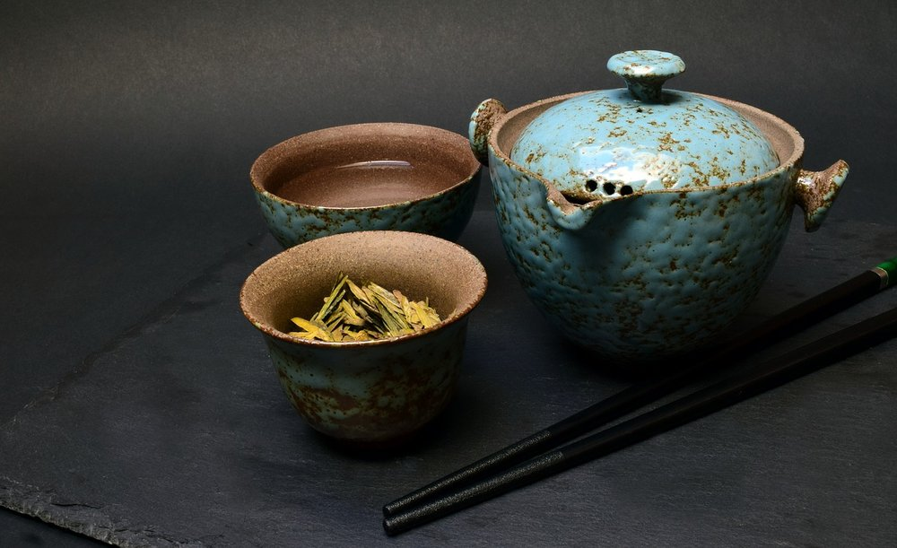 U. Leone,  Chinese Tea Set  (1 Jan 2018). CC BY 1.0 Alt text:  Photo of a turquoise ceramic chinese tea set with black chopsticks