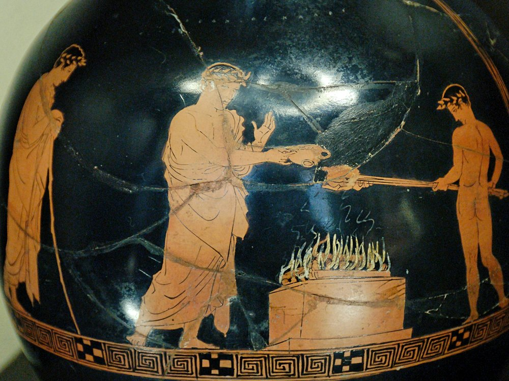 Kraipale Painter, Photographer: Jastrow,  Sacrifice scene Louvre G402 , 13 January 2007, Public Domain.  Detail from an Attic red-figure, sacrifice scene in Ancient Greece.   Fun fact: the smoke was also sometimes read as omens for the people!