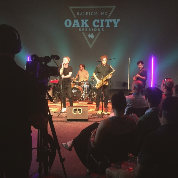 Hotline recording their episode of Oak City Sessions in front of a live studio audience.