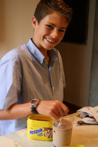 Caleb making chocolate milk