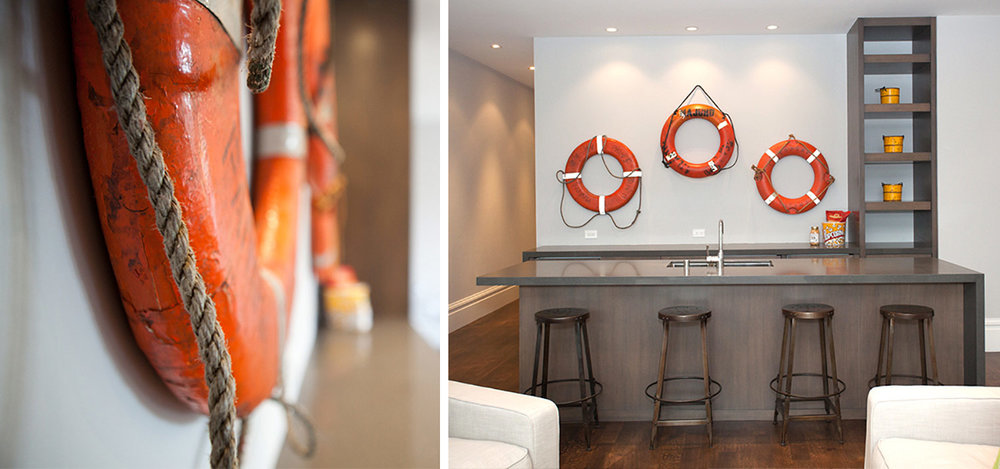 Bar with bar stools, sink and life preservers hung on the wall, barstools, marine art