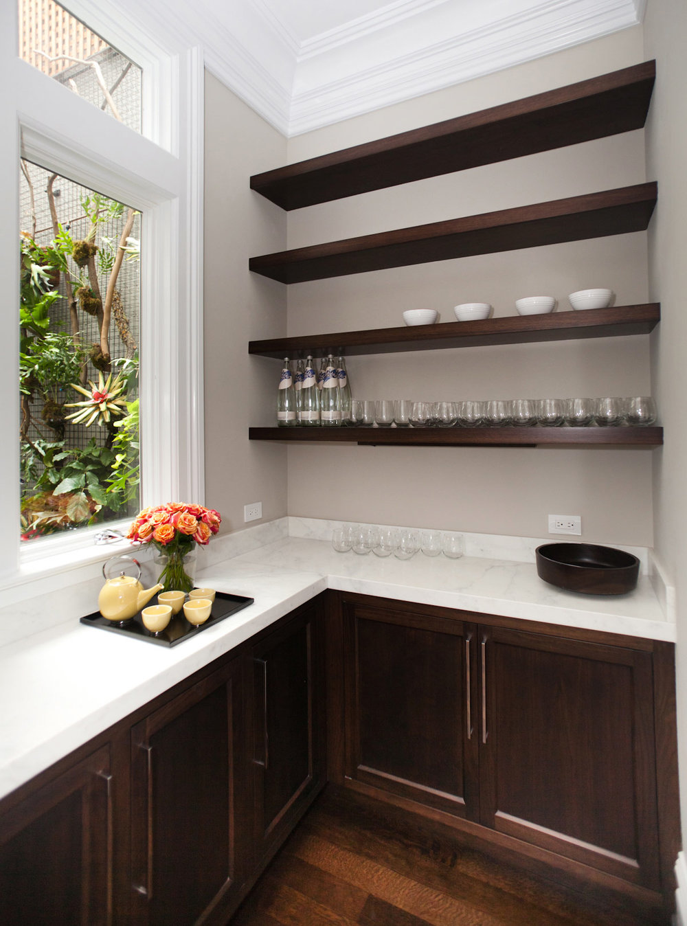 bar, cabinetry, door pulls, marble counters, garden wall, hanging plant wall, floating shelves, hardwood floors