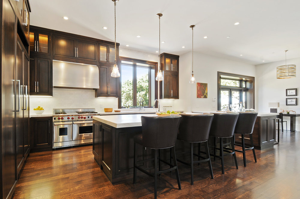 ktichen, cabinetry, hardwood floors, wolf stove, marble counters, barstools, kitchen pendant, stainless steel range