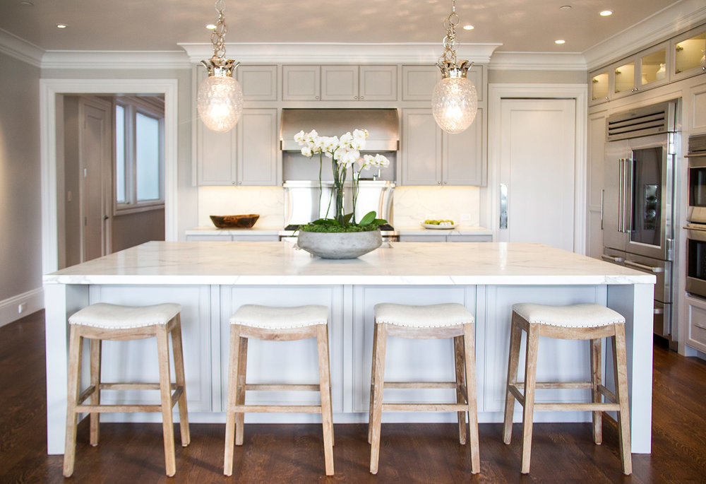 kitchen, white, marble, simple, lighting, counters, stainless steel, appliances, backsplash, barstools, hardwood floor, cabinets