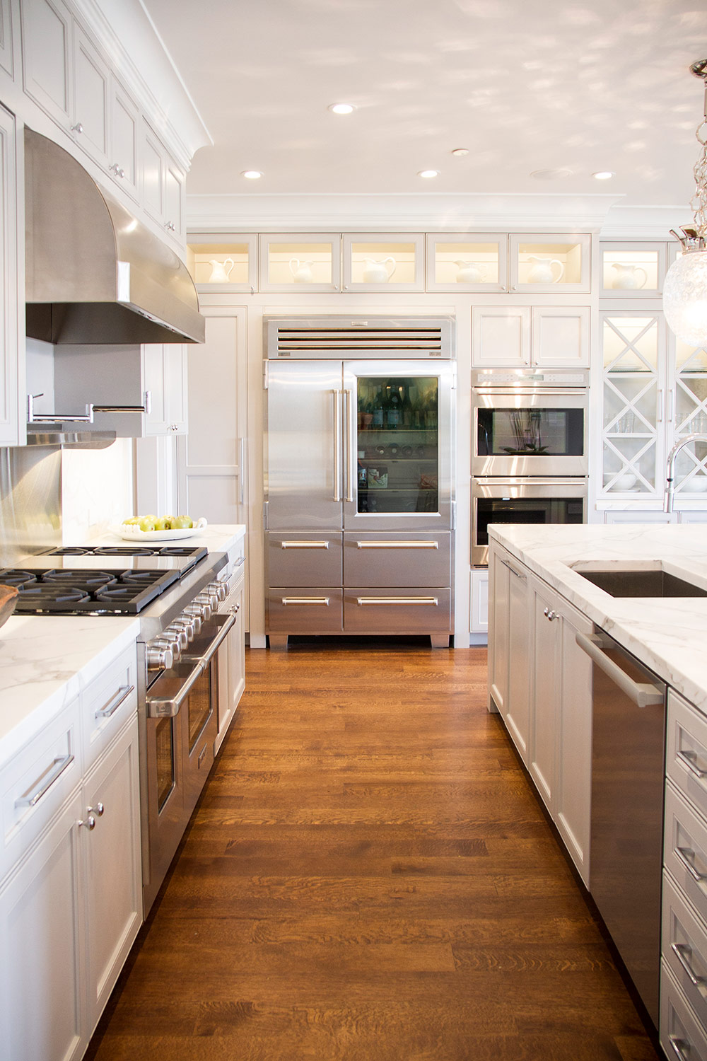 kitchen, white, simple, stainless steel, fridge, marble counters, overhead lighting, modern