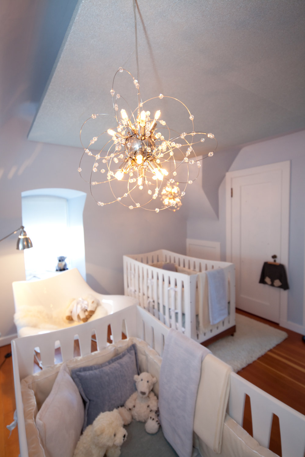 nursery, crib, modern, light, white, baby blue, chandelier, elegant, open, soft tones, soft textures