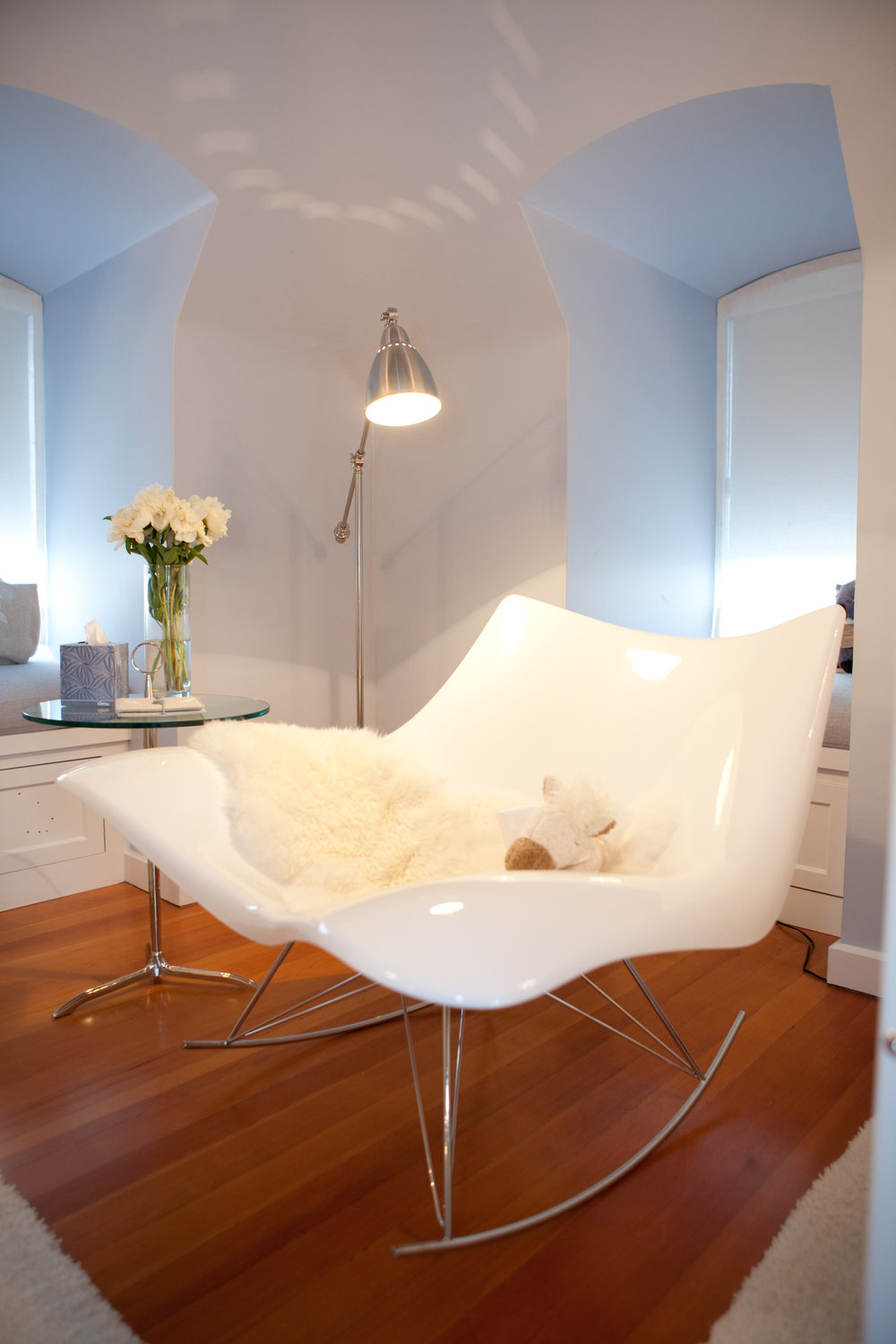 nursery, white, hardwood floor, sitting area, nursing chair, fur, lighting