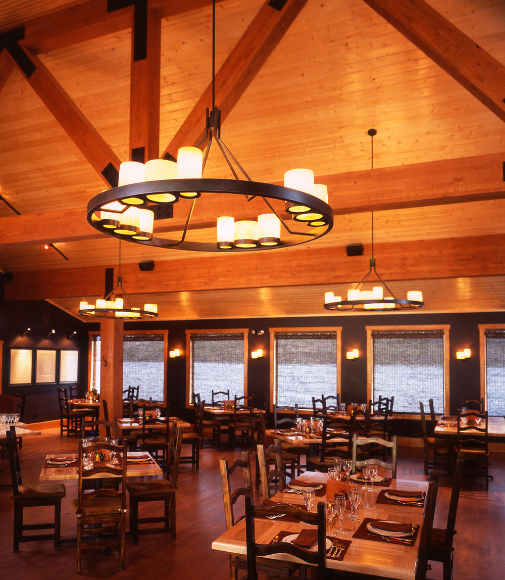 wyoming, wood, lake, lodge, leather, seating, dining room, rich textures, warm tone, rustic, western, chandelier, open layout