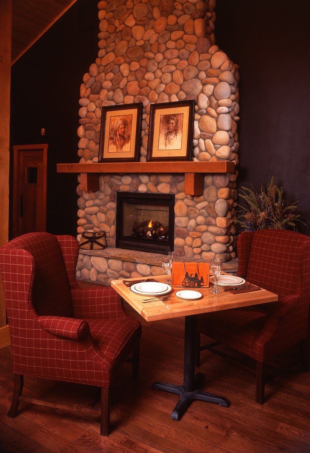 wyoming, lodge, wood, stone fireplace, dark textures, dark tones, hardwood floors, dining table