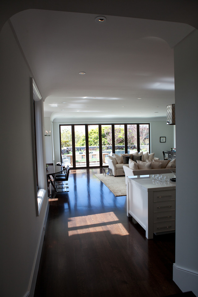 kitchen to living room, open floor plan, details, island, marble, dark floors, airy, soft tones