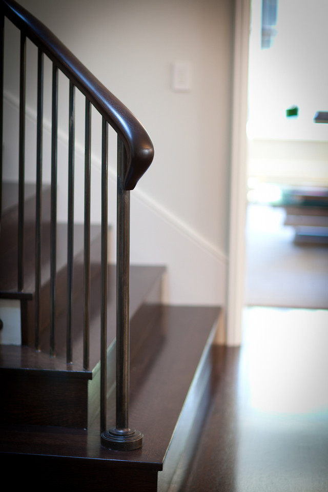 hardwood floor, staircase, stair railing, traditional staircase