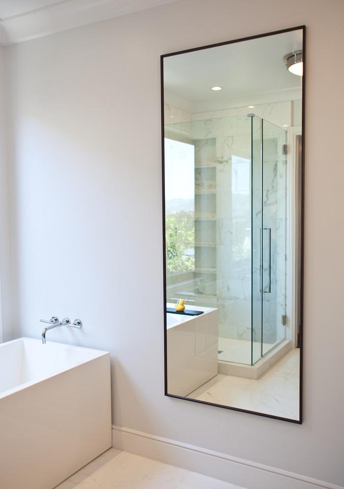Bathroom, modern bathroom, tub, polished chrome faucet, full length mirror
