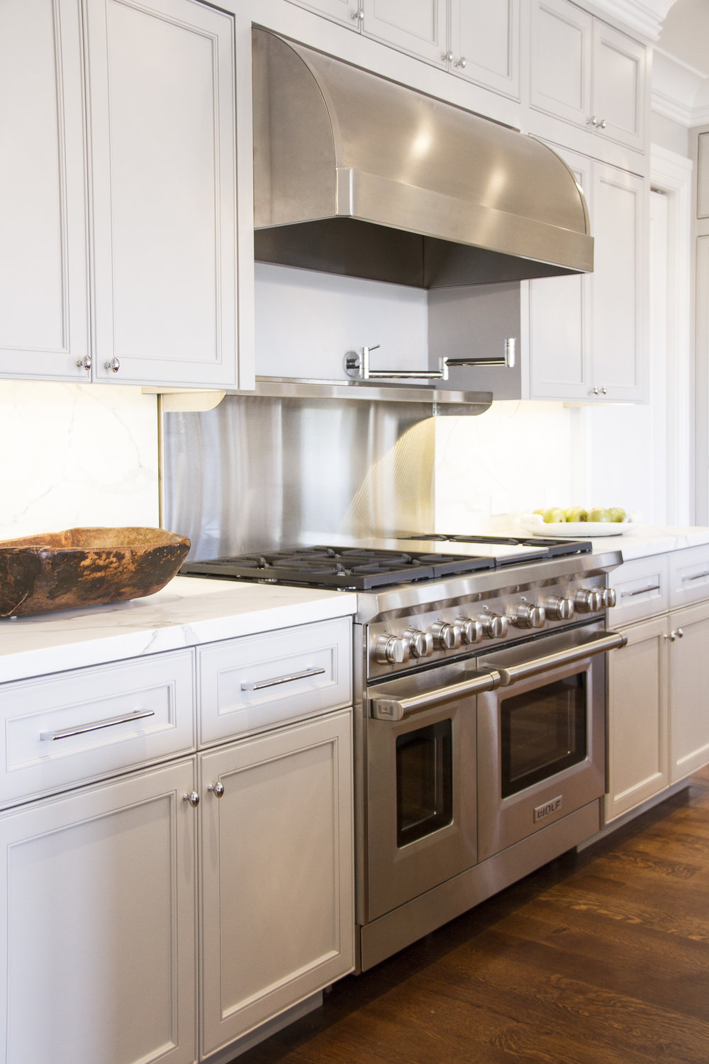 kitchen, white, oven, stainless steel, hardwood floor, marble counters, neutral cabinets