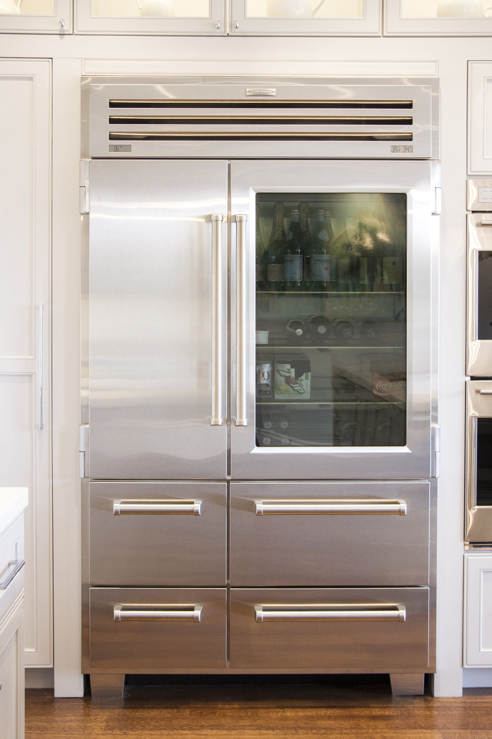 kitchen, fridge, stainless steel, white kitchen, simple, lighting, window cabinets, hardwood floor