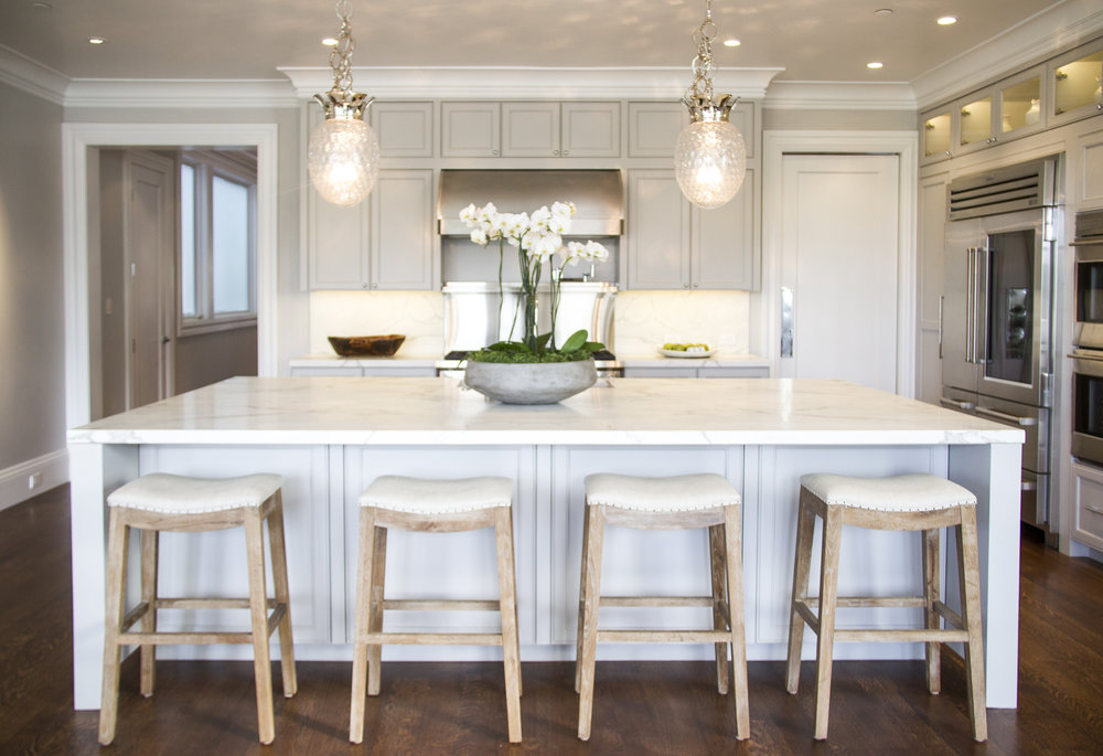 white, kitchen, marble counters, barstools, hardwood floor, chandelier, cabinets, stainless steel, open kitchen, clean, light
