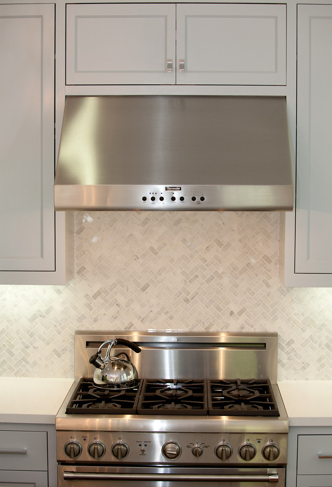 stainless steel, stove, herringbone backsplash, marble backsplash, kitchen, marble counters