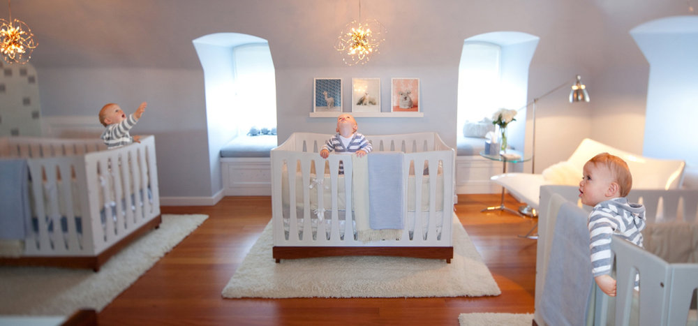 nursery, lighting, hardwood floor, open space, soft textures, baby blue, crib, white, window