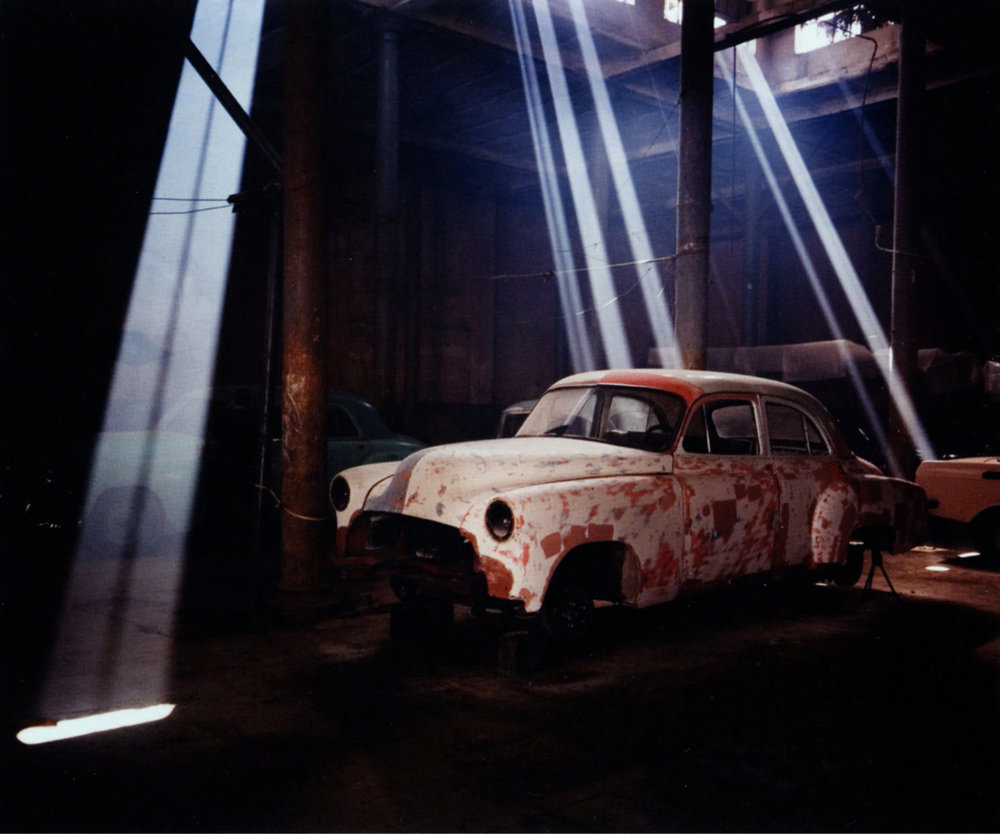 Nell CAMPBELL   Chevy in Garage at Teniente Rey y Cuba, Havana   2002