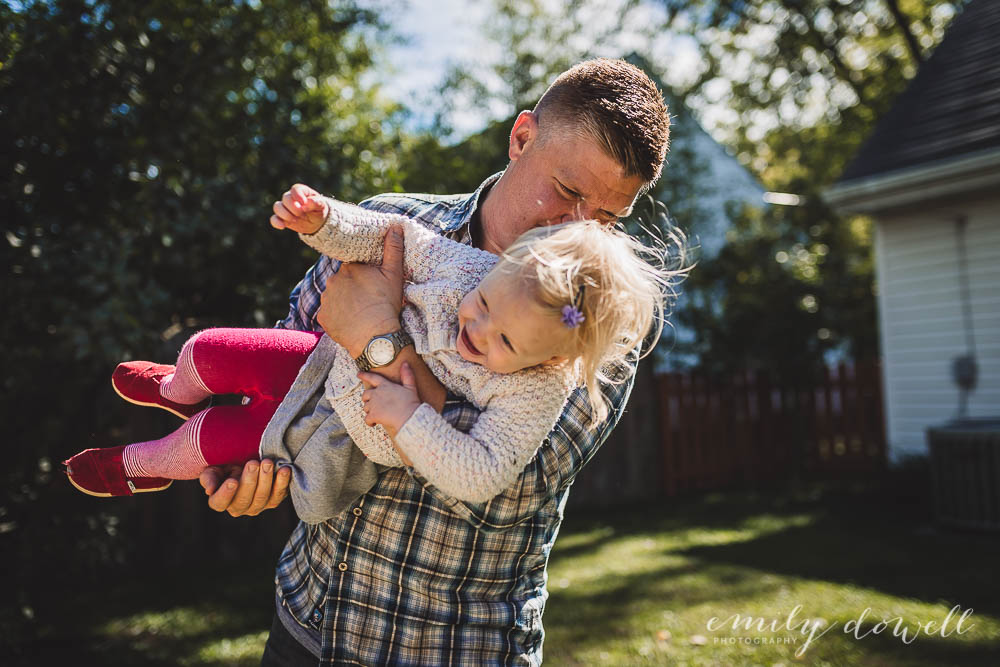 laughing child in father's arms
