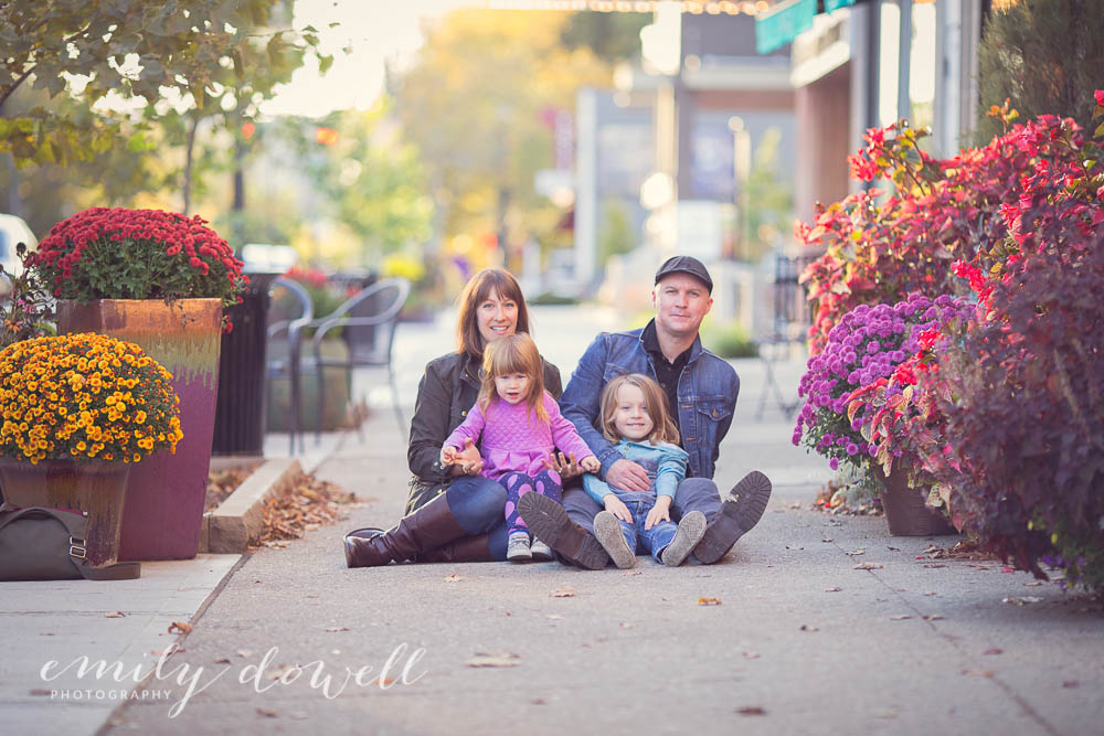 family portrait in urban setting with flower planters
