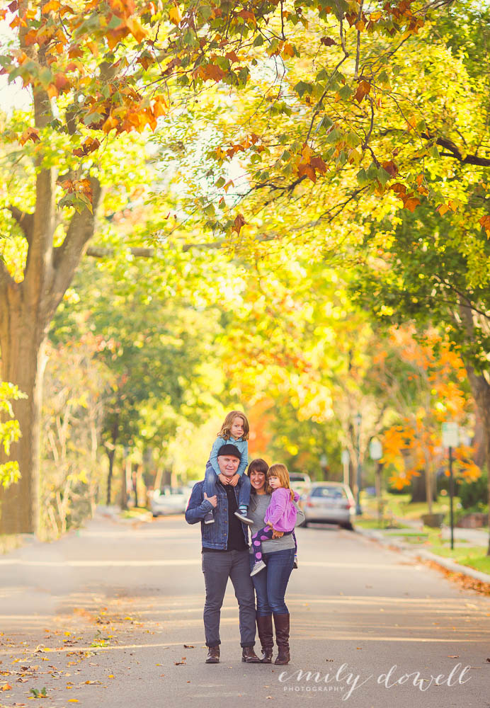 Family portrait on tree lined street in the fall