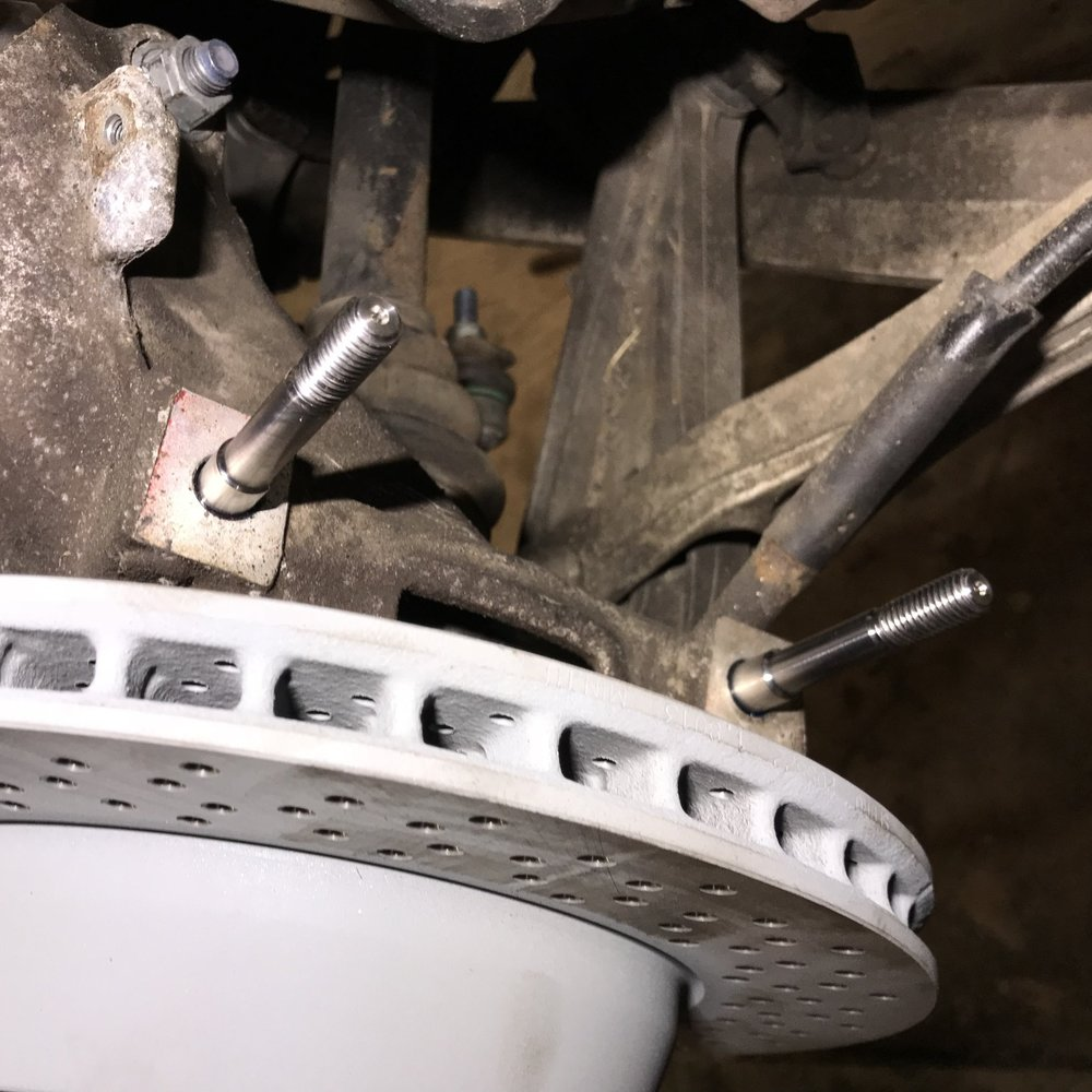 Caliper Studs - The threads on the end of the standard caliper bolts corrode, usually stripping the hub threads when removing the bolt to remove the brake caliper itself.To solve this issue and prevent being stranded with a stripped hub, we install caliper studs.