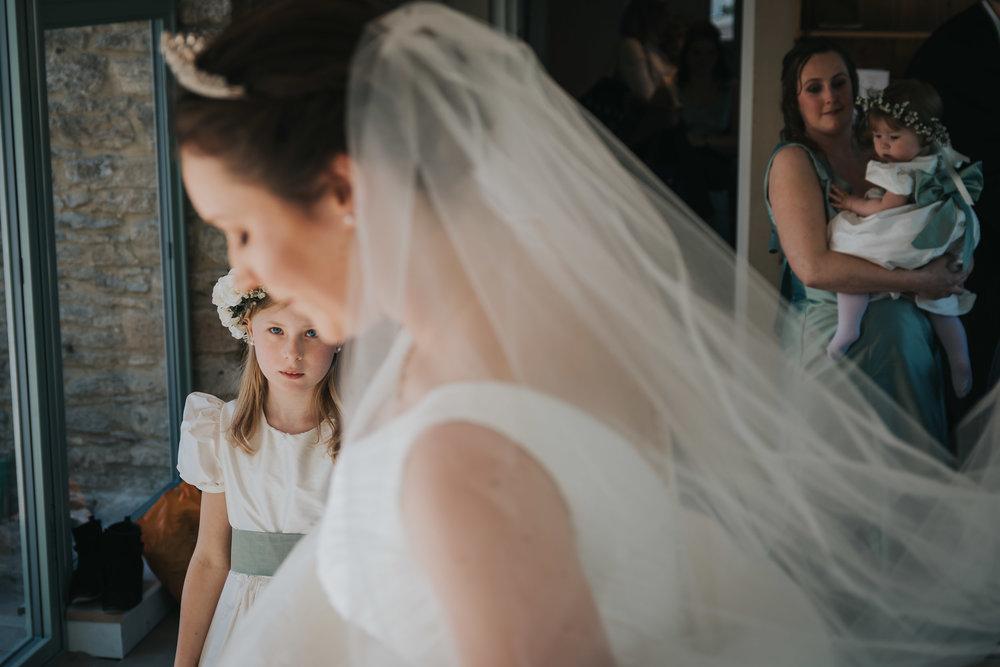 Wedding Photographers Hertfordshire - Flower Girl Watchig Bride