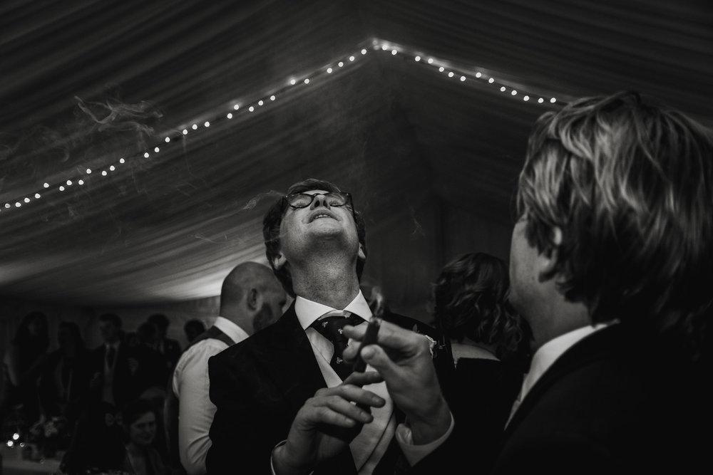 Wedding Photographers Hertfordshire - Groom Smaoking Cigar