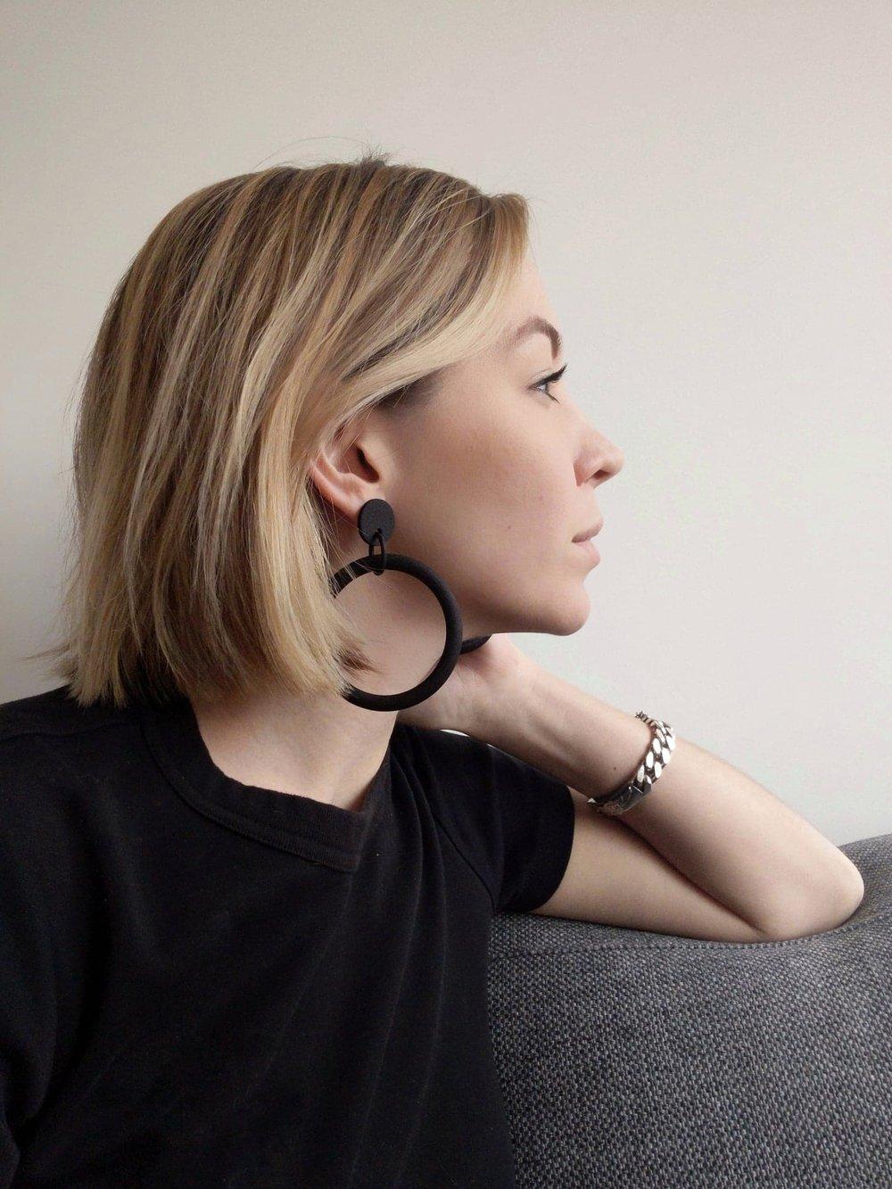 Leanne Luce wearing 3D printed black plastic hoops