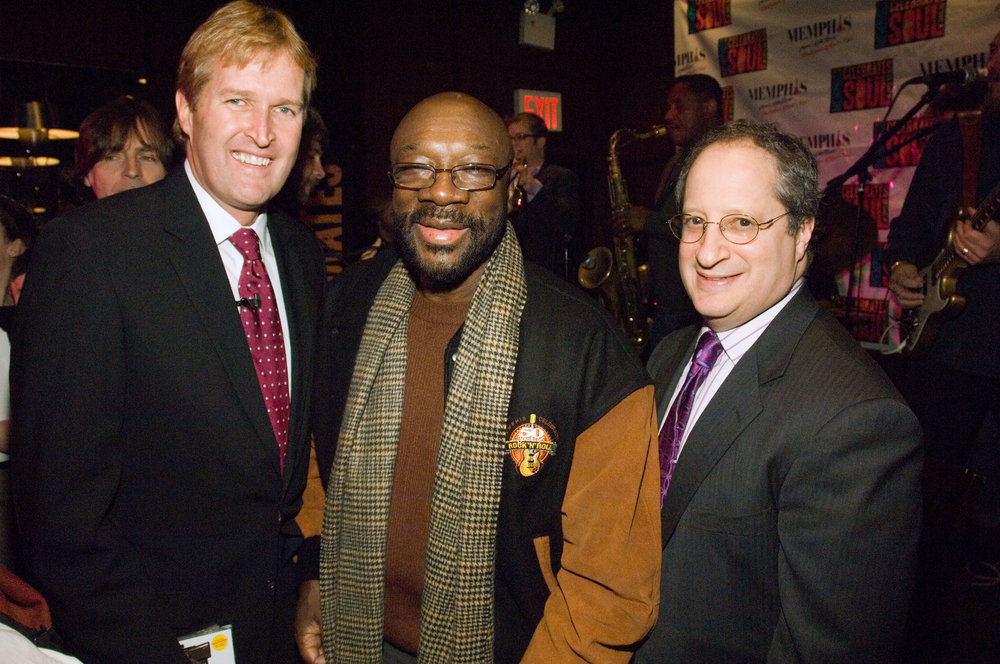 Kevin Kane, President of the Memphis Convention and Visitors Bureau, and Tom Goodman celebrate 50 years of soul music with legendary singer and composer Isaac Hayes.