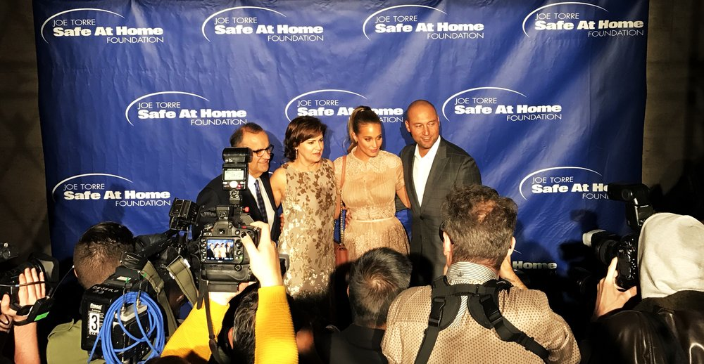 Joe Torre, Ali Torre, Hannah Davis and Derek Jeter pose for media on the red carpet at The Safe At Home Foundation's annual gala at Cipriani 25 Broadway.