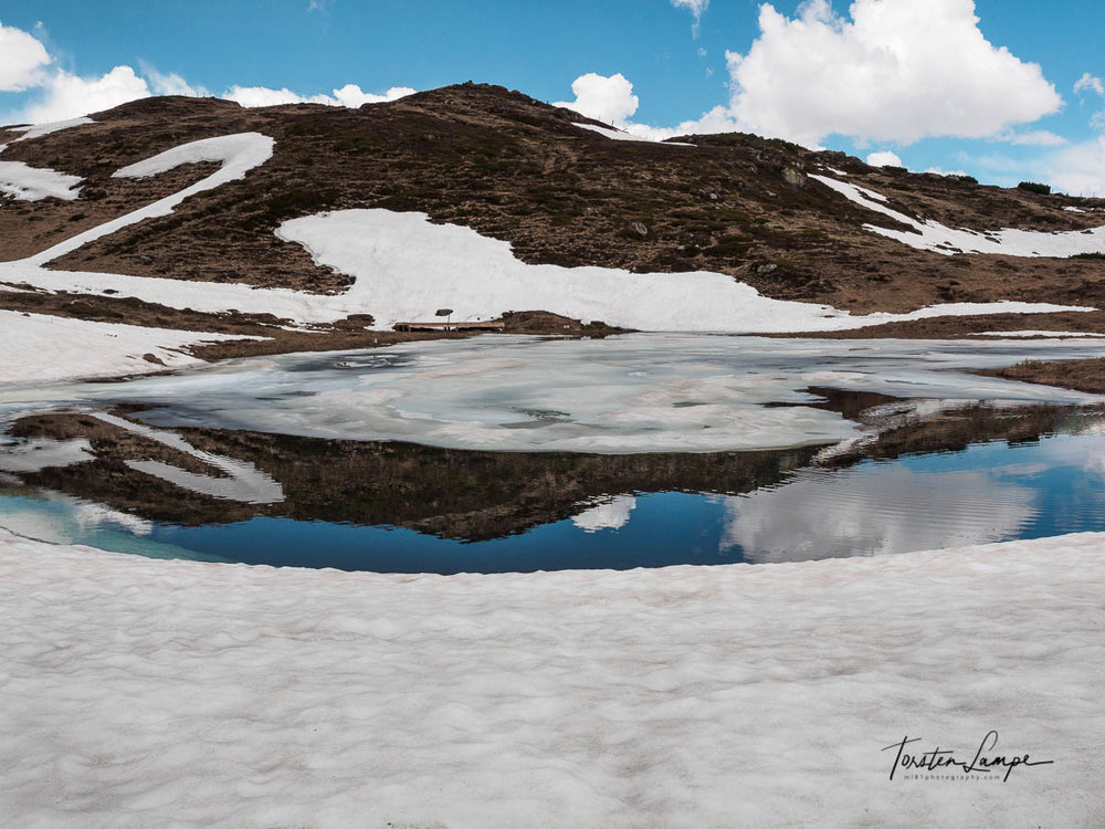 We came across this small pond at the Jaufenpass. Still ice on it but able to take an image of this wonderful scene.
